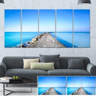 Designart 'Concrete and Rocks Pier' Seascape Photo Canvas Print