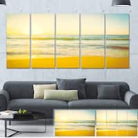 Designart 'Calm and Colorful Sunset at Beach' Seascape Photo Canvas Print