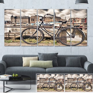 Designart 'Bike Over Bridge in Amsterdam' Cityscape Photo Canvas Print - Brown