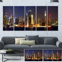 Designart 'New York Skyline at Night' Cityscape Photo Large Canvas Print - Brown