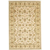 Hand-knotted with Agra Design Area Rug  (5' 4 x 8')