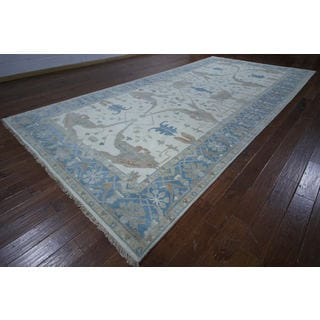 Hand-knotted Turkish Oushak Ivory and Blue Wool Rug (8' 2 x 16' 9)