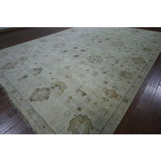 Hand-knotted Oriental Ivory Wool Rug (9' 11 x 13' 1)