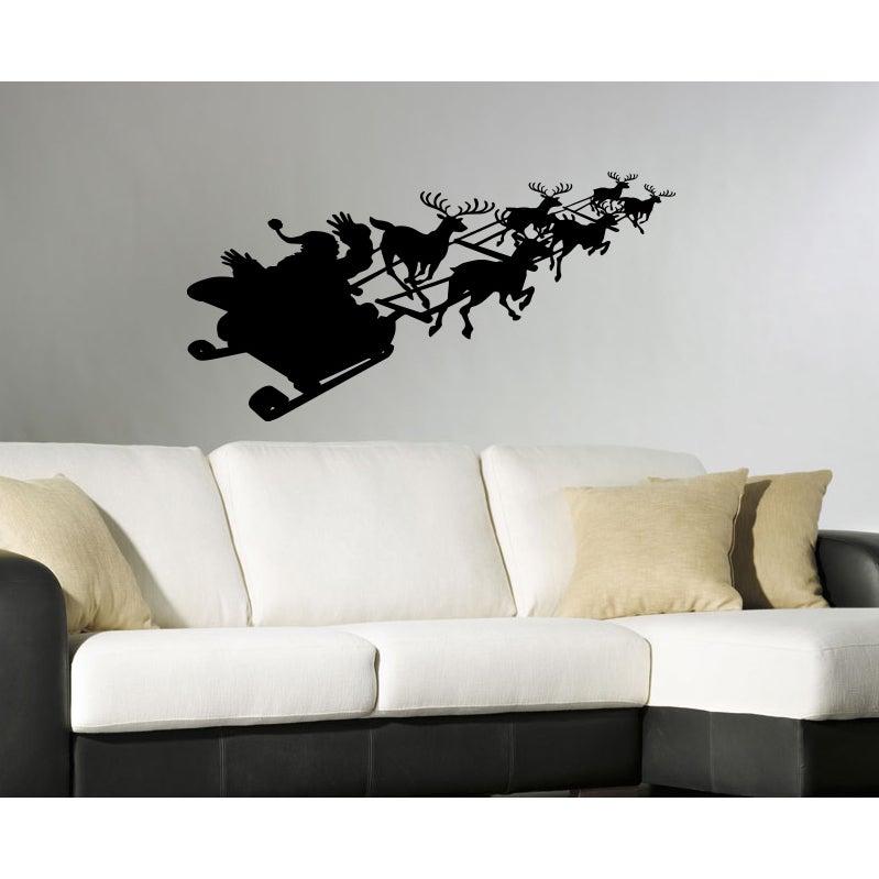 Santa Claus in a sleigh with reindeer Wall Art Sticker De...