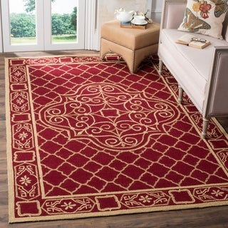 Safavieh Hand-hooked Easy to Care Maroon/ Gold Rug (6' x 9')