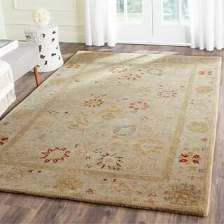 Safavieh Handmade Antiquity Taupe/ Beige Wool Rug - 6' x 9'