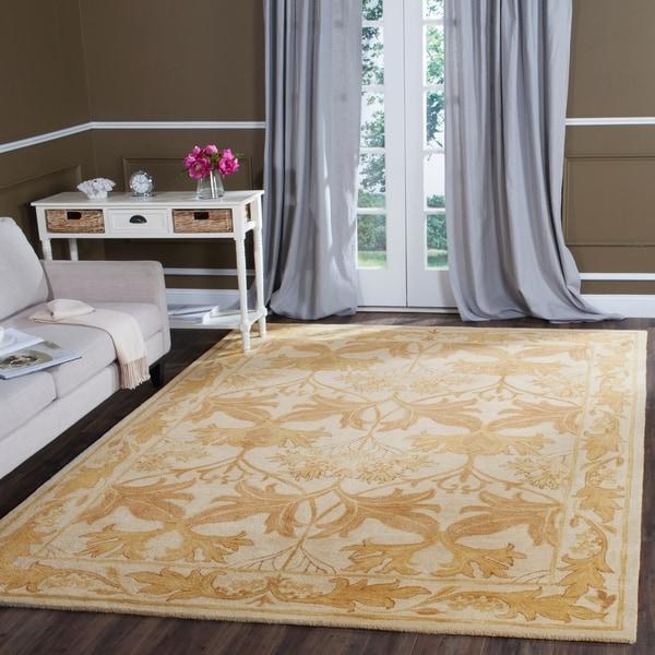 Safavieh Handmade Antiquity Beige/ Gold Wool Rug - 7'6 x 9'6