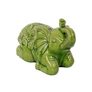 Sitting Ceramic Elephant With Raised Trunk Embellished With Beautiful Motif On The Back