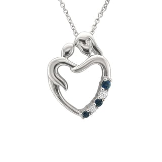 Montebello Jewelry 14k White Gold 1/8ct Blue Sapphire and Diamond Accent Mother Heart Pendant Necklace (H-I, I1)