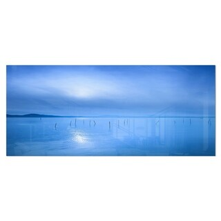 Designart 'Blue Water Surface in Morning' Seascape Photo Metal Wall Art