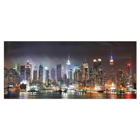 Designart 'Lit NYC Manhattan Skyline' Cityscape Photo Metal Wall Art