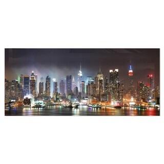 Designart 'Lit NYC Manhattan Skyline' Cityscape Photo Metal Wall Art