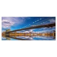 Designart 'Sunset Over Brooklyn Bridge' Cityscape Photo Metal Wall Art