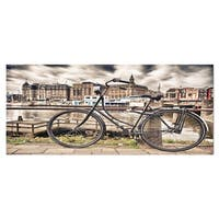 Designart 'Bike Over Bridge in Amsterdam' Cityscape Photo Metal Wall Art