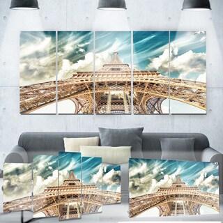 Designart 'Eiffel Tower Under Blue Sky' Photography Metal Wall Art