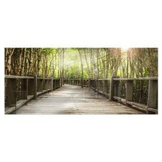 Designart 'Wooden Bridge in Forest' Landscape Photography Metal Wall Art