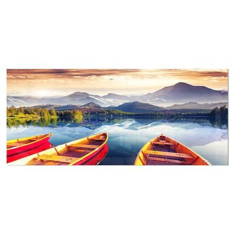 Designart 'Boats Heading to Lake' Landscape Metal Wall Art