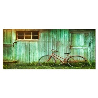 Designart 'Old Bicycle against Barn' Landscape Photo Metal Wall Art