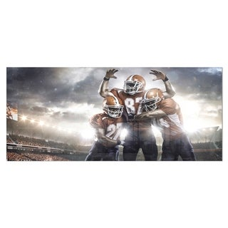 Designart 'American Football Players on Stadium' Sports Metal Wall Art