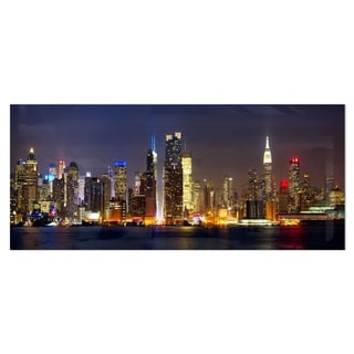 Designart 'New York Skyline at Night' Cityscape Photo Metal Wall Art