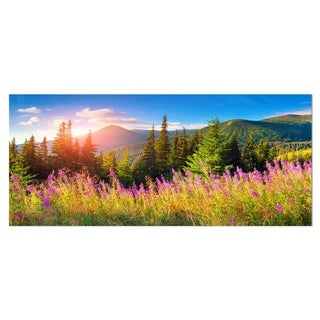 Designart 'Mountains with Pink Flowers' Landscape Floral Metal Wall Art
