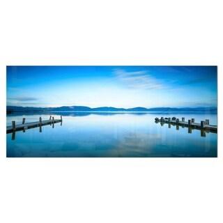 Designart 'Two Wooden Piers in Blue Sea' Seascape Photo Metal Wall Art