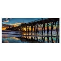 Designart 'Oceanside Pier at Evening' Landscape Photo Metal Wall Art