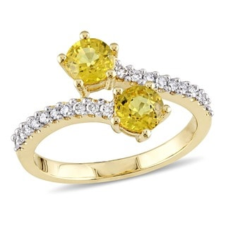 Miadora Signature Collection 10k Yellow Gold Yellow Sapphire and 1/5ct TDW Diamond Bypass Ring (G-H, I2-I3)