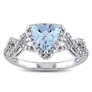 Miadora 10k White Gold Trilliant-cut Sky Blue Topaz and 1/7ct TDW Diamond Infinity Ring (G-H, I2-I3)