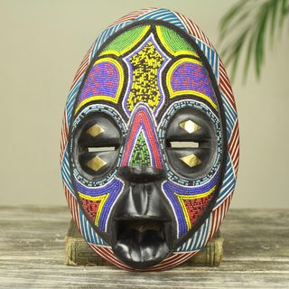 Handcrafted Sese Wood 'Colors of Ghana' Mask (Ghana)