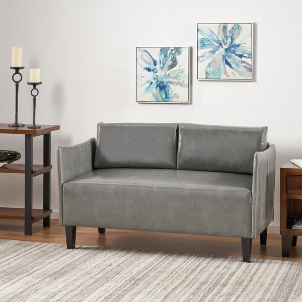 Nyx Modern Faux Leather Upholstered Loveseat by Christopher Knight Home. Opens flyout.