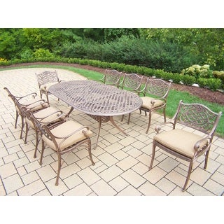 Dakota Cast Aluminum 9-piece Dining Set, with 84 x 42-inch Oval Table, and 8 Cushioned Arm Chairs