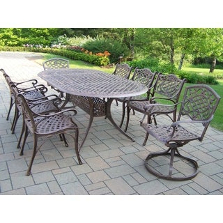 Explorer Cast Aluminum/Polyester/Steel 9-piece Dining set with 84-inch x 42-inch Oval Table, 6 Arm Chairs, and 2 Swivel Rockers