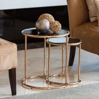 Danya B™ Set of 2 Nested Round End Tables with Black Glasstop and Rose Gold Metal Frame