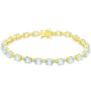 Dolce Giavonna Gold Over Sterling Silver Oval Cut Blue Topaz XO Link Bracelet
