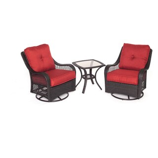 Hanover Orleans Red Rattan Outdoor Three-piece Swivel Rocking Chair Set