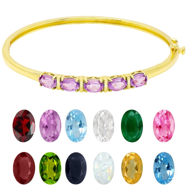 Dolce Giavonna Gold Over Sterling Silver Oval Gemstone Birthstone Bangle. Opens flyout.