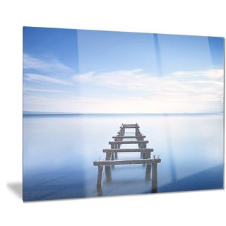 Designart 'Jetty Remains in Blue Lake' Seascape Photo Metal Wall Art
