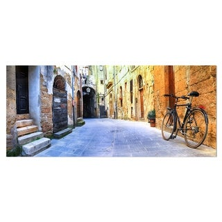 Designart 'Pictorial Street of Old Italy' Cityscape Metal Wall Art