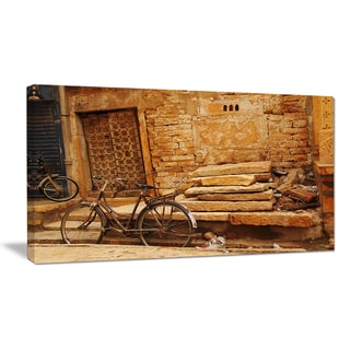 Bicycle against Brown Wall - Landscape Photography Canvas Print