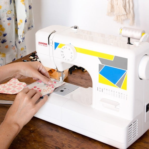 Janome MOD-11 Easy-to-Use Sewing Machine with 11 Stitches and 5-piece Feed Dogs