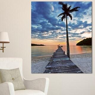 Wooden Pier and Palm Tree - Seashore Photo Canvas Art Print - Blue