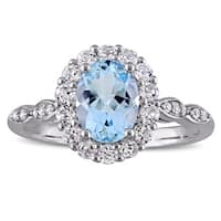 Miadora 14k White Gold Oval-cut Sky Blue Topaz White Topaz and Diamond Accent Halo Engagement Ring