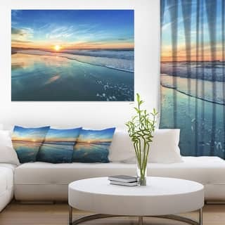 Blue Seashore with Distant Sunset - Seashore Canvas Wall Art https://ak1.ostkcdn.com/images/products/12210835/P19057319.jpg?impolicy=medium