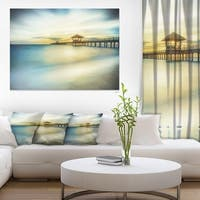 Blue Tinged Seashore with Distant Pier Sea Pier Wall Art Canvas Print