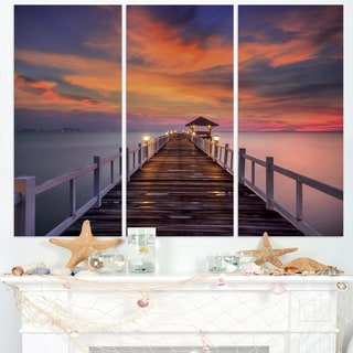 Dark Seashore Pier under Colorful Sky - Sea Pier Wall Art Canvas Print