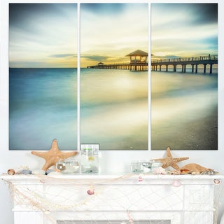 Blue Tinged Seashore with Distant Pier - Sea Pier Wall Art Canvas Print