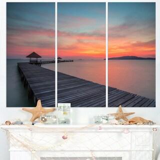 Gloomy Seashore with Long Wood Pier - Sea Pier Wall Art Canvas Print