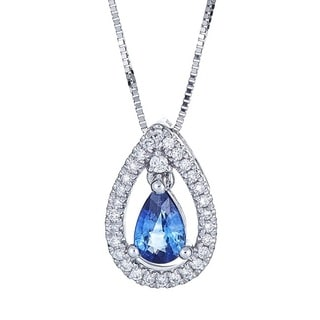 Anika and August 18k White Gold Ceylon Blue Sapphire and 1/8ct TDW Diamond Pendant (G-H, I1-I2)
