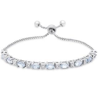 Dolce Giavonna Sterling Silver Blue Topaz and Diamond Accent Oval Adjustable Slider Bracelet